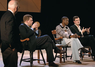 From left: John Paris, SJ (standing), Michael Moreland MA '97, Michele Goodwin JD '97, Gareth Cook. Photograph: Justin Knight