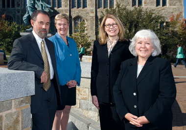 From left: Henry Braun (education), formerly of the Educational Testing Service; Patricia DeLeeuw, vice provost for faculties; Amy Hutton (accounting), formerly of Dartmouth's Tuck School; and Mary Ann Glynn (organizational studies), formerly of Emory's Goizueta School. Photograph: Gary Wayne Gilbert