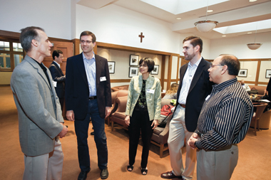 Fichman (left) and Kane (second from right) with colleagues from England, Michigan, and Virginia, in the anteroom of the Lynch Conference Center. Photograph: Frank Curran