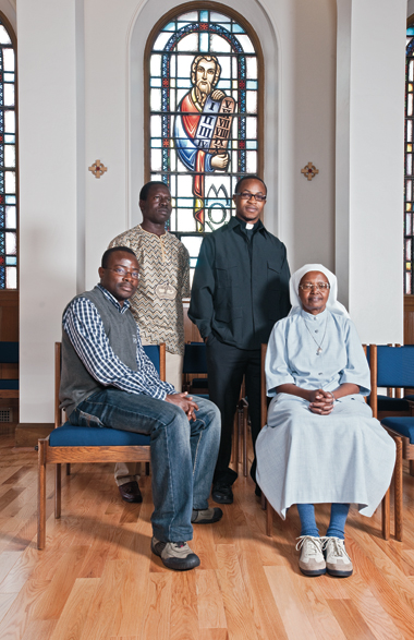 In the School of Theology and Ministry chapel, backed by a stained-glass Moses, are (from left): Hermann-Habib Kibangou, SJ, of the Republic of Congo; Jean Messingue, SJ, from Cameroon; Brian Banda, SJ, '09 from Zimbabwe; and Rwandan Dorothee Mukamurama (Sister Juvenal of the Benebikira Sisters). Photographs: Gary Wayne Gilbert
