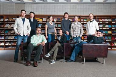 A group of master of theological studies students, in STM's 225,000-volume library on the Brighton Campus (from left): James O'Sullivan, Edward Kendrick, Daniel Cosacchi, Julie O'Heir, Marina Pastrana '08, Erik Hesla, Karl LaClair, Brett Thatcher, and Christopher Harrigan.