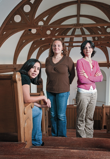Three of the women studying for a master of divinity degree, in the choir loft of the new chapel at 9 Lake (from left): Rebecca Camacho '07, Jocelyn Collen, and Jennifer Grieco.