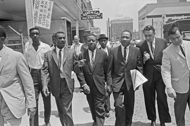 Center, left to right: Fred L. Shuttlesworth, Ralph Abernathy, and Martin Luther King Jr. in Birmingham, Alabama, on May 15, 1963. Image: © Bettmann / Corbis
