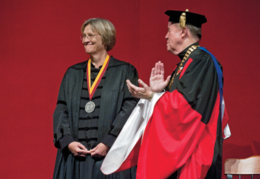 Faust, after receiving the Sesquicentennial Medal from Fr. Leahy on Robsham's stage. Photograph: Lee Pellegrini