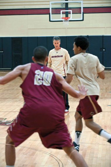 Donahue, overseeing defensive drills at the Power gym in September. At left is Lonnie Jackson '15; at right, Jordan Daniels '15. Photograph: Lee Pellegrini
