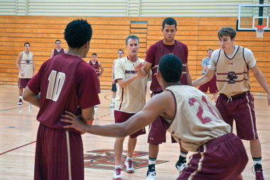 In the coaching circle are, clockwise, Donahue, Ryan Anderson '15, Eddie Odio '15, Olivier Hanlan '16, and Daniels. Photograph: Lee Pellegrini