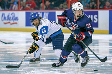 Carpenter manages the puck for Team USA during the world championship semifinal versus Finland, April 8. Photograph: Courtesy of Julie Carpenter