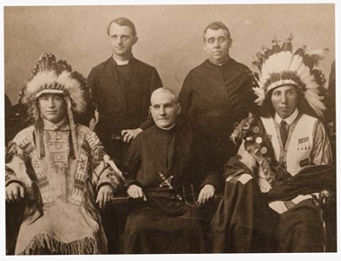 During a 1913 Catholic Missionary Congress held at Boston College's campus in the South End, Gasson (second from right)—or Zin Tka la Wanketuya, as the Sioux named him—posed with tribe members from South Dakota.  Photograph: Courtesy Georgetown Special Collections. Click images to enlarge.