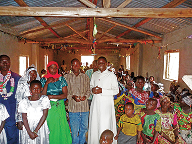 Mushobozi (in his white robe) at a mission church in northwest Tanzania. The occasion is a wedding Mass. Photograph: Courtesy of Fr. Leopold Mushobozi