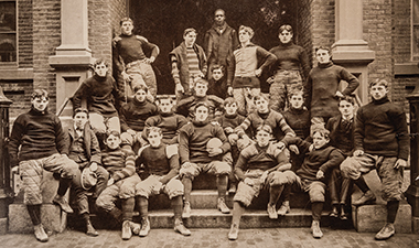 The 1897 football team on the steps of the James Street entrance to Boston College's first building. Photograph: Courtesy of John J. Burns Library Archive. Click image to enlarge.