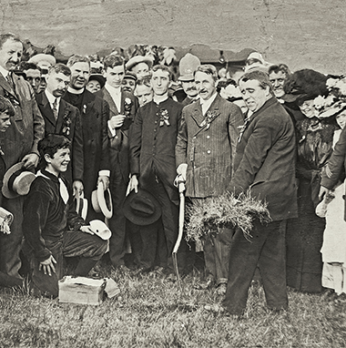 On June 19, 1909, University President Thomas I. Gasson, SJ, displays the first sod turned for construction of the Recitation Building (now Gasson Hall). Photograph: Courtesy of John J. Burns Library Archive. Click image to enlarge.