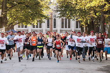 Runners starting out on Linden Lane. Lacrosse teammates are in red and white T-shirts. Photograph: Lee Pellegrini