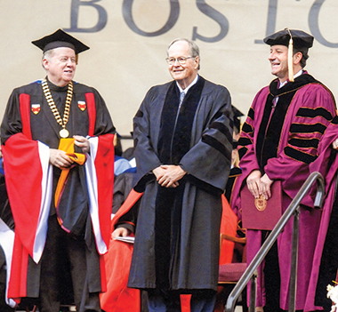 McIntyre (center), receiving an honorary doctorate from University President William P. Leahy, SJ, at Commencement 2011. At right is University Trustee (Chair at the time) William A. Geary '80. Photograph: Lee Pellegrini