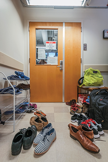 Above: The entrance to physicist Kenneth Burch's Laboratory for Assembly and Spectroscopy of Emergence (clean shoes recquired).