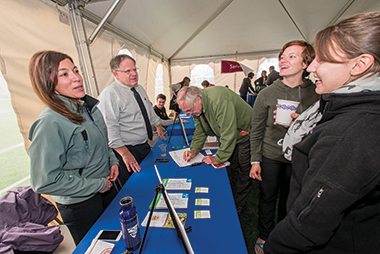 "Amanda King (left) and Robert Pion, directors of sustainability at Bentley University and Boston College, respectively, at the ""What Can I Do?"" fair. Photograph: Lee Pellegrini"