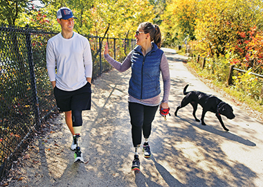 Patrick, Jess, and Rescue walk around Cambridge's Fresh Pond on October 6, 2015. Photograph: John Tlumacki / Boston Globe