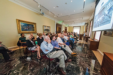 Netzer (at podium) gives an account of the museum before a standing-room-only crowd in a first-floor reception room, during the museum's grand opening for faculty, staff, and neighbors on September 10. Click image to enlarge.