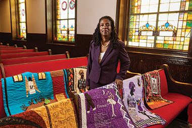 Lamkin, in Mother Emanuel with some of her quilts. Her memorial to the Emanuel Nine is front and center, to the left of a quilt by her mother. Photograph: Milton Morris. Click image to enlarge.