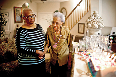 In 2012, the woman at right was living with her daughter (left). Her granddaughter had given up her job to be her daytime caregiver. Image: Kainaz Amaria / NPR