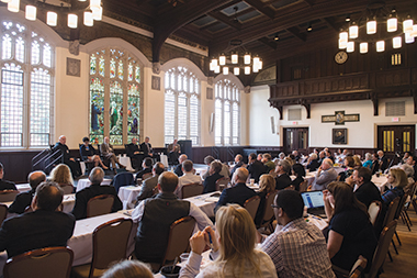 Panelists discuss the Wisconsin meeting's legacy in Gasson 100. From left: Presidents Sean Sheridan of the Franciscan University (Steubenville) and LeMura of Le Moyne, journalist Peter Steinfels, presidents Jenkins of Notre Dame and Hemesath of St. John's (Minnesota), and moderator James M. O'Toole, the Clough Millennium Professor of History at Boston College. Image: Christopher Soldt. Click image to enlarge.