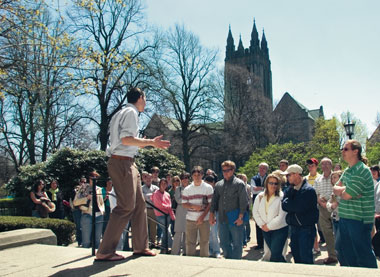 Tour guide Matthew Putorti '06 of BC's Student Admission Program on the Bapst steps. Photograph: Lee Pellegrini