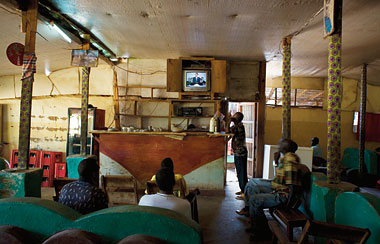 Residents of Kakuma's Ethiopian community watch CNN at the Unity Hotel and Coffee Shop. Photograph: J. Carrier
