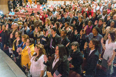 Ninety-four take the Oath of Allegiance. Photograph: Justin Knight