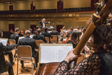 John Finney rehearses the Boston College Symphony Orchestra. Photograph: Gary Wayne Gilbert