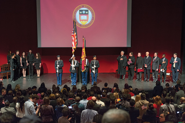 On the Robsham stage, from left, BC bOp!, the ROTC color guard, and speakers. Photograph: Justin Knight