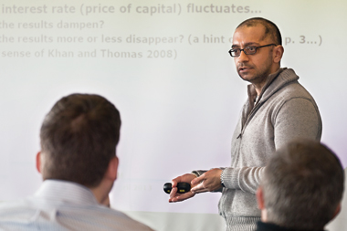 Boston College economist Sanjay Chugh responds to a BU presentation. Photograph: Caitlin Cunningham