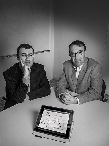 Sönmez (left) and Ünver. The figure and formulas  on the tablet screen describe a chain of kidney exchanges set in motion by an altruistic organ donor. Photograph: Gary Wayne Gilbert