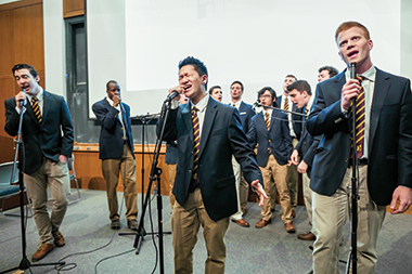 Up front, from left:  John Lapointe '15, Pat Fei '18, and Goebel during a concert on March 13. Photograph: Christopher Huang