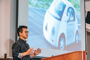 Google's Chow, with an image of a self-driving car: Bigger data can help solve bigger problems. Photograph: Gary Wayne Gilbert