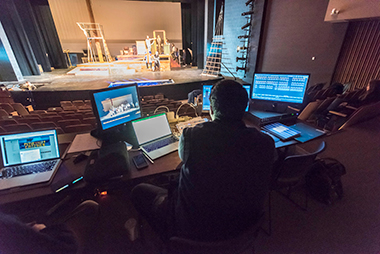 Samuel Biondolillo '18 checks lighting levels during an April 19 rehearsal for the theater department's production of Peter and the Starcatcher in Robsham Theater. Click image to enlarge.