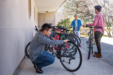From left: Bike BC's Ben Li '19, Chris Liu '18, and Alessandro Zenati '21 outside Duchesne Hall on the Newton Campus. Image: Peter M. Julian