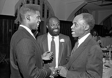 At the 1989 Martin Luther King Jr. Scholarship Ceremony, from left: Tenth member Raymond Sykes '90 (the recipient), Dan Bunch '79, MSW'81, and University Trustee David Nelson '57, JD'60, H'79. image: Gary Wayne Gilbert