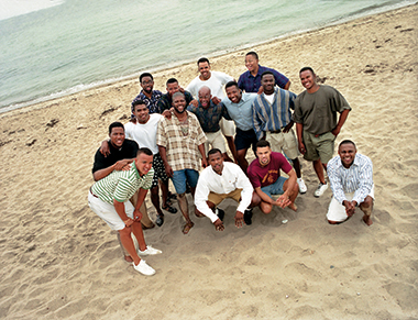 A Tenth reunion, Martha's Vineyard, July 1995. Back row, from left: Clifford Isaac '90, Redd, Sid Levy*, Gaines. Middle row: Robert Ross '91, Herve Clermont*, Sykes, John Downing '91, William Gibson*, Jean-Pierre, Cadet. Front: Bishop, Moran, Steve Pemberton '89, H'15, Pierre.  *Did not attend Boston College. Image: Geoff Why. Click image to enlarge.