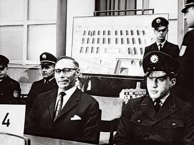 Defendant and former Gestapo staff sergeant Wilhelm Boger, 56, before a diagram of Auschwitz in 1965. Photograph: Corbis/UPI