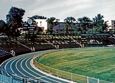 Early photo of Alumni Stadium, before artificial turf, removal of the track, and expansion of the seating. Photograph: University Archives, John J. Burns Library, Boston College