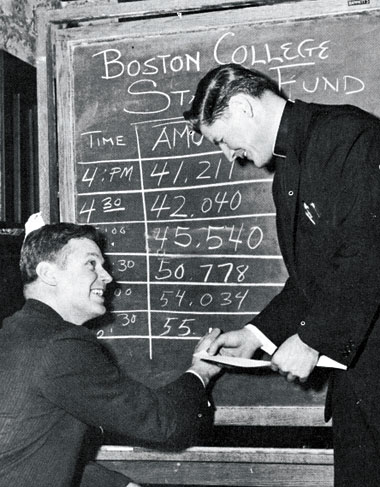 Athletic director Flynn and Fr. George Kerr '41, a former All-American guard, track drive's progress. Photograph: University Archives, John J. Burns Library, Boston College