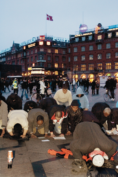 Muslims pray, protest, in Copenhagen, February 1, 2006. Photograph: SCANPIX/Reuters/Corbis/Lars Helsinghof