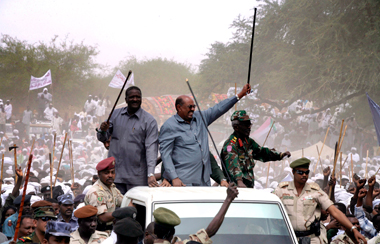 Omar Hassan al-Bashir (center), arriving in the South Darfur town of Sabdo, Sudan, March 18, 2009. Photograph: Philip Dhil/epa/Corbis