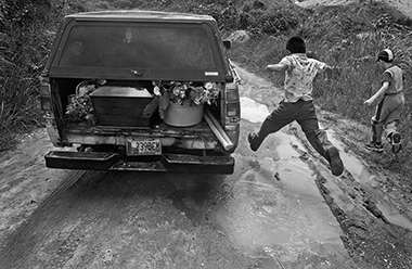 In this 2005 photograph, the casket contains the body of a young man killed in a Guatemalan prison. Photograph: Victor Blue