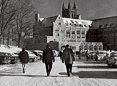 Students walking between McElroy and Lyons halls, in the winter of 1964. Photograph: Courtesy of John J. Burns Library Archive