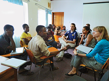 Trekkers (from center right) Derek Switaj '15, Sacha Ramjit '15, and Bagnani meet a MEST team. Photograph: John Gallaugher