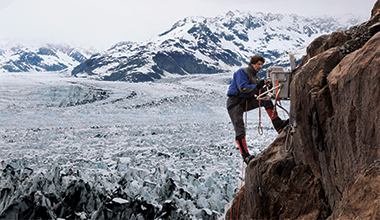 Balog, with one of his time-lapse cameras, on a cliff overlooking southern Alaska's Columbia Glacier in May 2007. Photograph: Tad Pfeffer / Extreme Ice Survey. Click on image to enlarge.