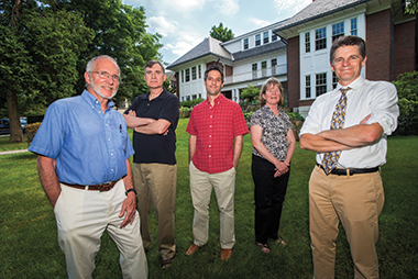The major's founding faculty include (from left) William Petri (biology), Bill Stevenson (organizational studies), Brian Gareau (sociology), Clare O'Connor (biology), and Snyder, outside Waul House. Photograph: Lee Pellegrini