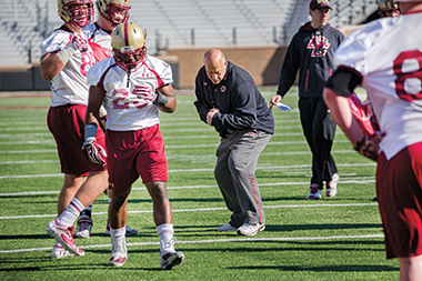 Addazio works with members of the offense.