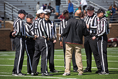 A conference with the referees before the Jay McGillis Memorial Spring Game on April 5.
