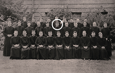 Neenan (spotlighted in middle row) circa 1950, at the Jesuit novitiate in Florissant, Missouri. Photograph: Courtesy of the Missouri Province of the Society of Jesus